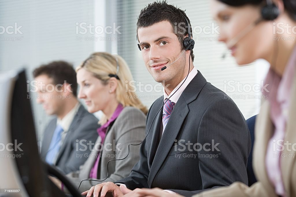 Smiling male telephonist royalty-free stock photo