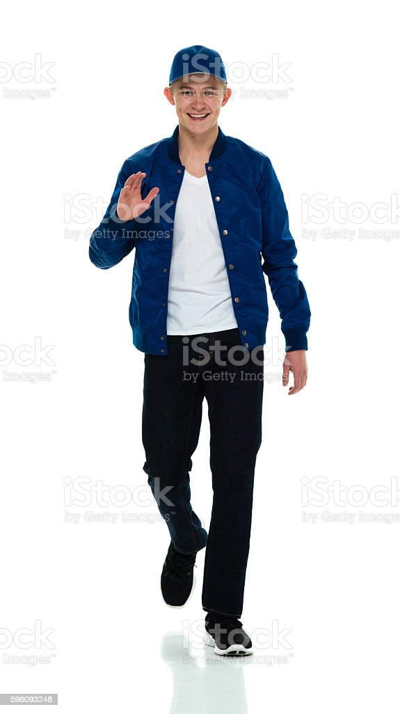 Smiling male walking and waving hand royalty-free stock photo