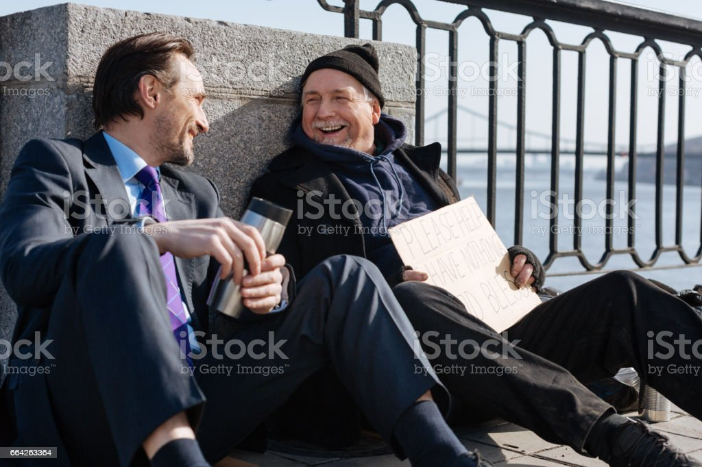 Smiling males looking at each other stock photo