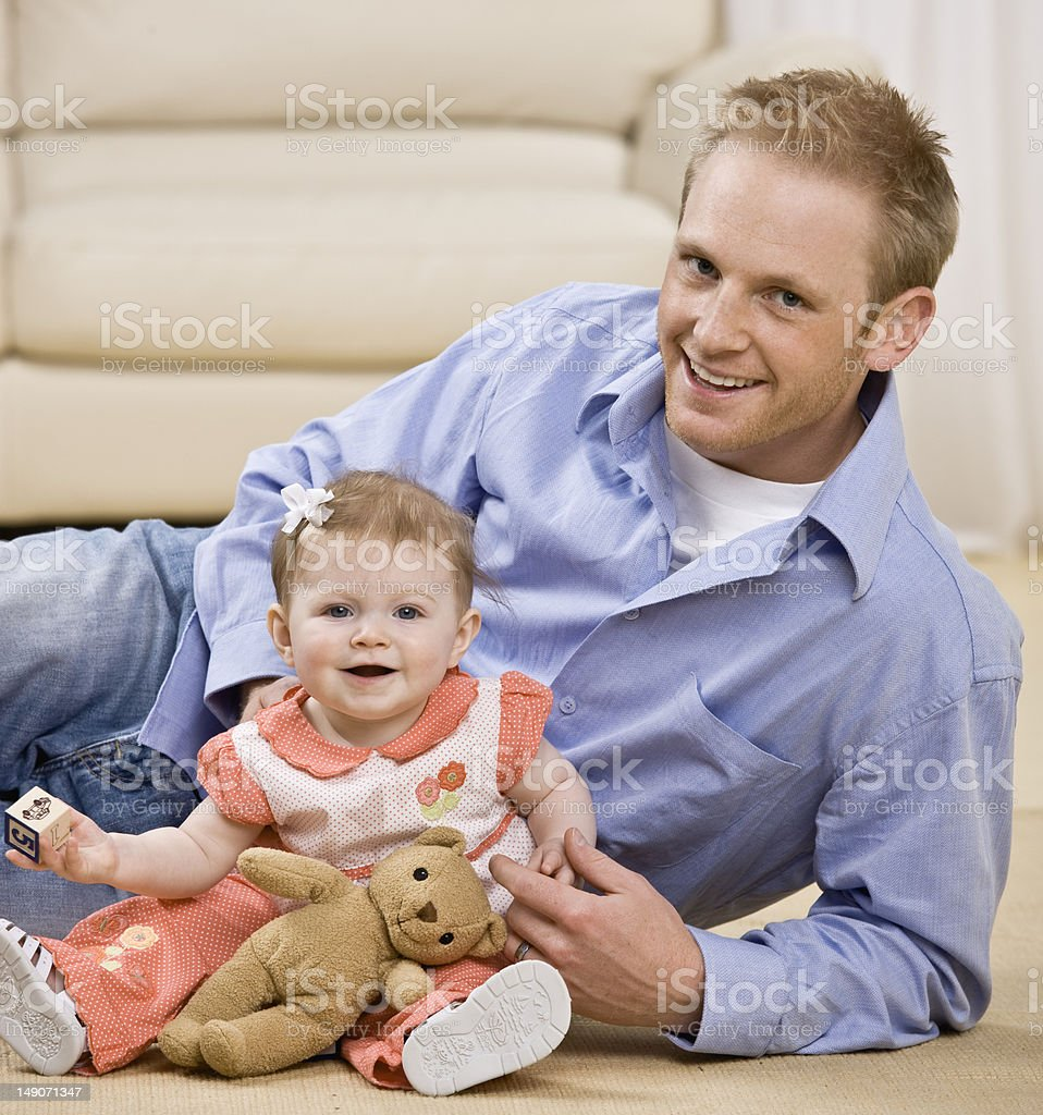 Smiling Man And Baby Daughter royalty-free stock photo