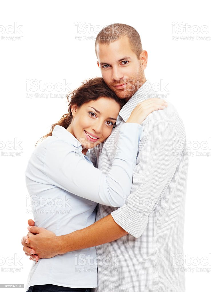 Smiling man and woman in warm embrace, both wearing white royalty-free stock photo