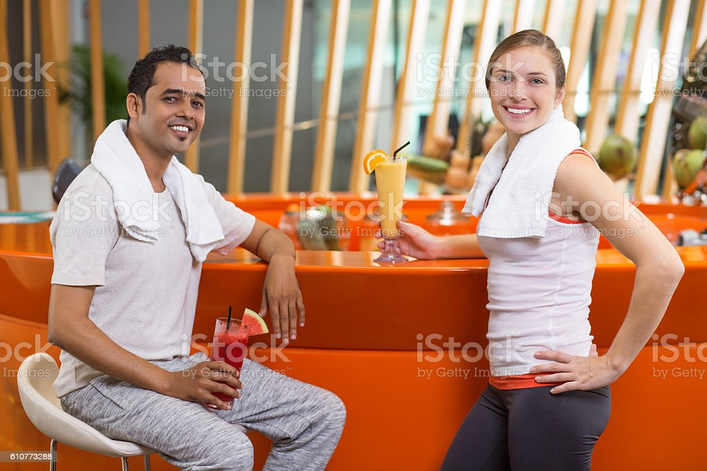 Smiling Man and Woman with Smoothies in Sport Bar stock photo