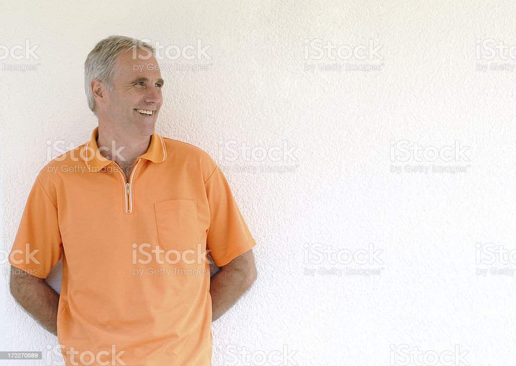 smiling man at wall royalty-free stock photo