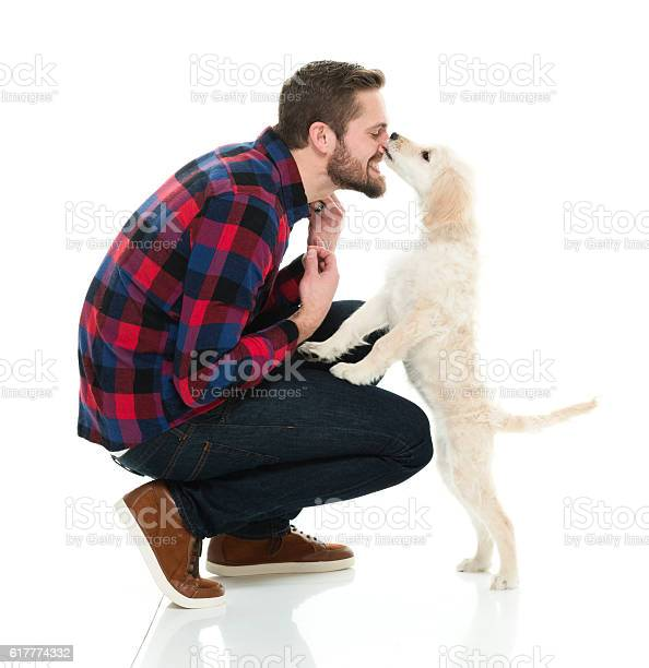 Smiling man bonding with his dog picture id617774332?b=1&k=6&m=617774332&s=612x612&h=ncfuodewuthvgoksmyznveciuiucrizhqhuqyyvt6ti=