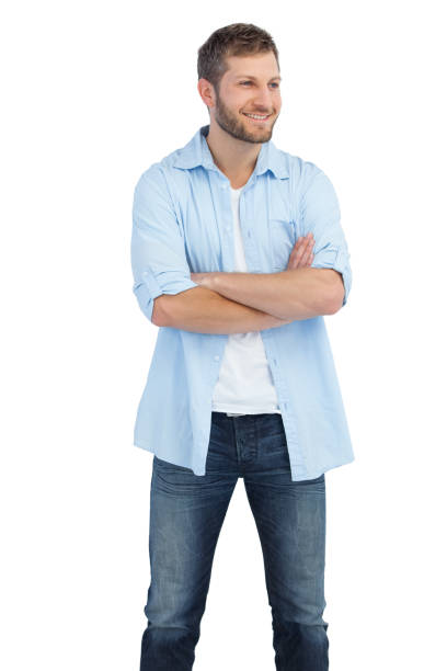 Smiling man crossing arms and looking away stock photo