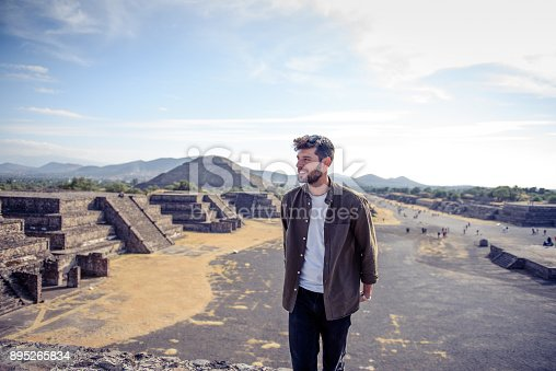Smiling man discovering Mexican pyramids