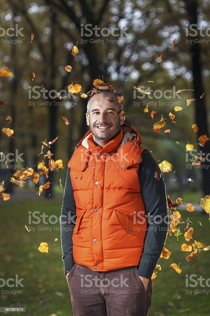 Smiling man ejoying an Autumn royalty-free stock photo