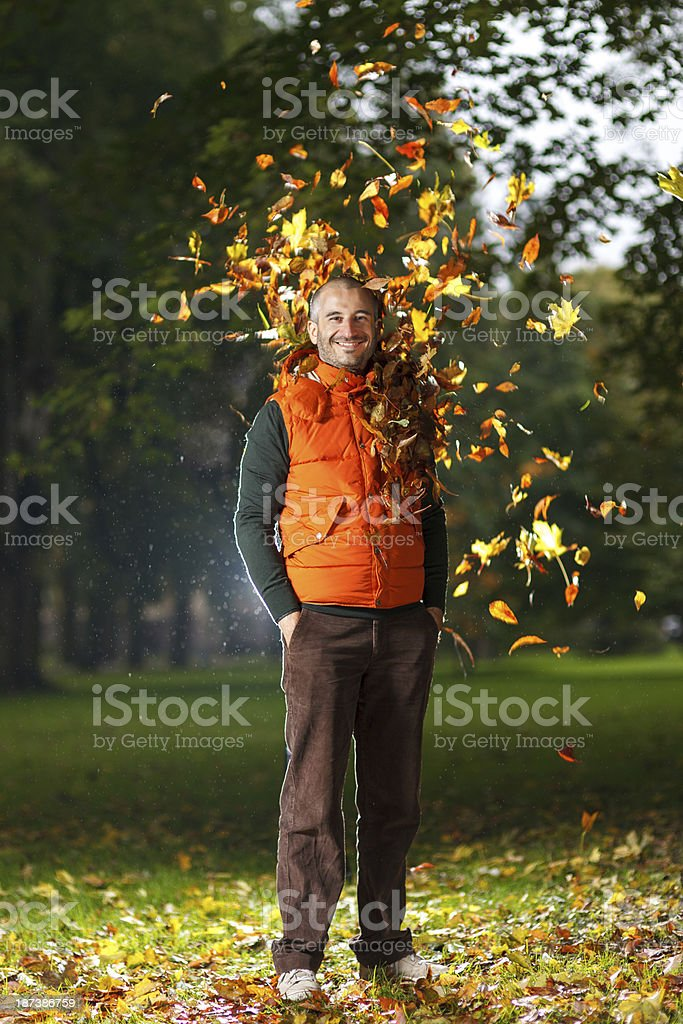 Smiling man ejoying an Autumn royalty-free stock photo