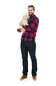 Smiling man embracing with his puppyhttp://www.twodozendesign.info/i/1.png