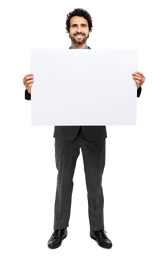 Smiling man holding a blank board