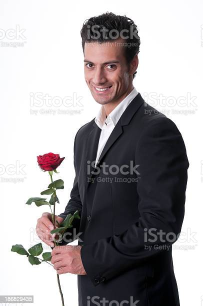 Smiling man holding a single red rose picture id186829435?b=1&k=6&m=186829435&s=612x612&h=ujtyyo083rgeqp 4h9j7 xxf3xplmxulys up2hzcxw=