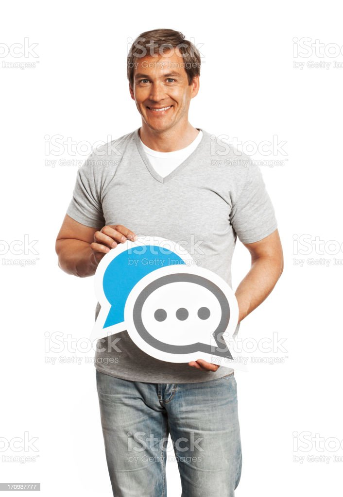 Smiling man holding chat sign isolated on white background. royalty-free stock photo