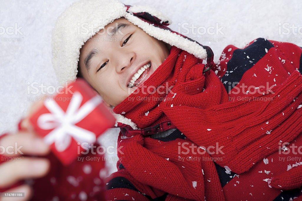 Smiling man holding christmas gift royalty-free stock photo