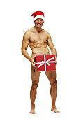 istock Smiling man holding gift box 500834852