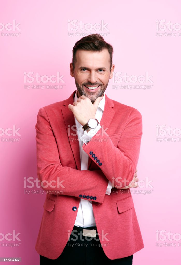 Smiling man holding his chin stock photo