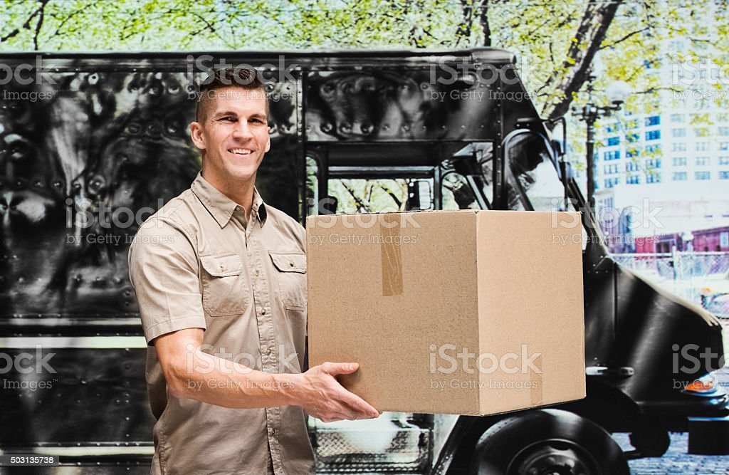 Smiling man holding package stock photo