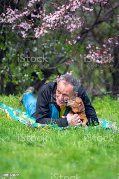 Smiling man hugs his funny dog picture id953163872?b=1&k=6&m=953163872&s=612x612&h=ljtnarlvqc2wabok9  rutkix9iwpvxyvjdcckddcde=