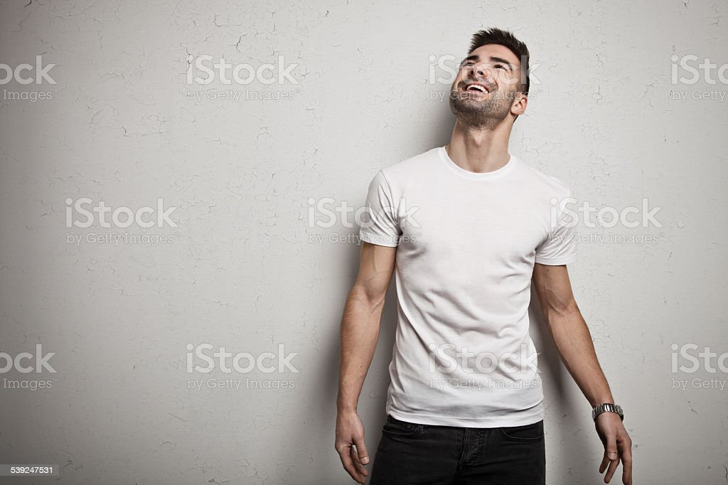 Smiling man in blank t-shirt stock photo
