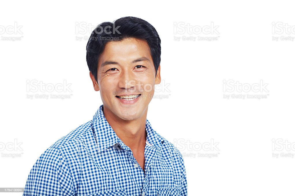 Smiling man in blue and white shirt over a white backdrop stock photo