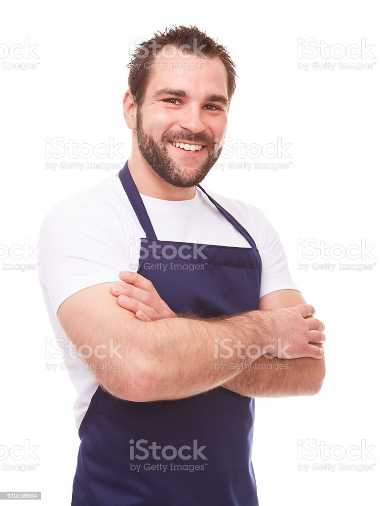 Smiling man in blue apron stock photo