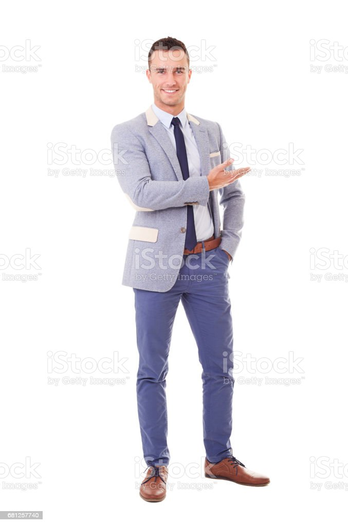 Smiling man in blue jacket showing empty copyspace stock photo