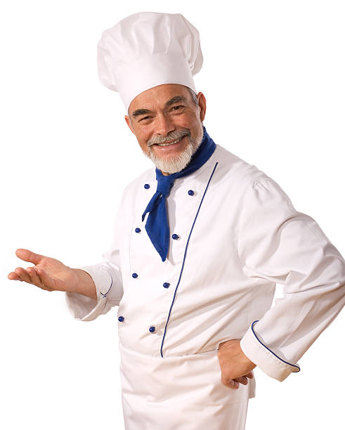 Smiling man in chef's uniform over a white background Portrait of happy attractive cook on the white background chef's whites stock pictures, royalty-free photos & images