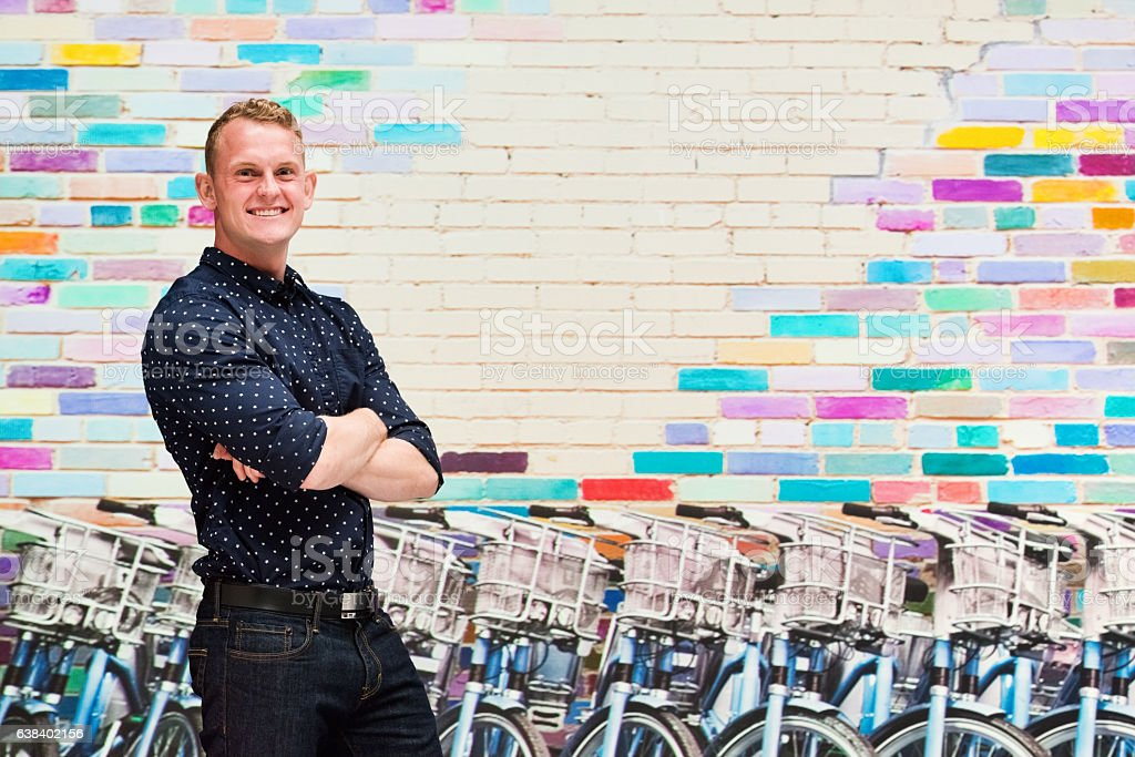 Smiling man in front of bicycle stock photo