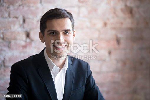 825082848istockphoto Smiling man in suit 1036274148