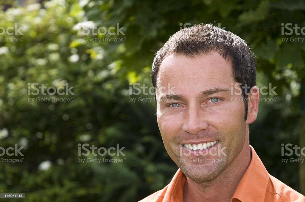 smiling man in the garden royalty-free stock photo