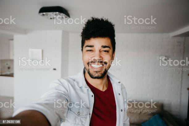Smiling man in the living room is taking a selfie picture id813935198?b=1&k=6&m=813935198&s=612x612&h=iedg6snnjci0oipmuw3zdoia9u1yvb4hj5uj9kafwx8=