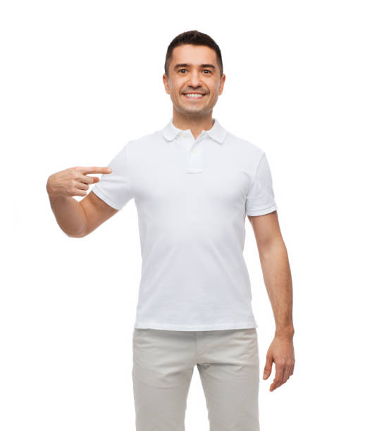 smiling man in t-shirt pointing finger on himself stock photo
