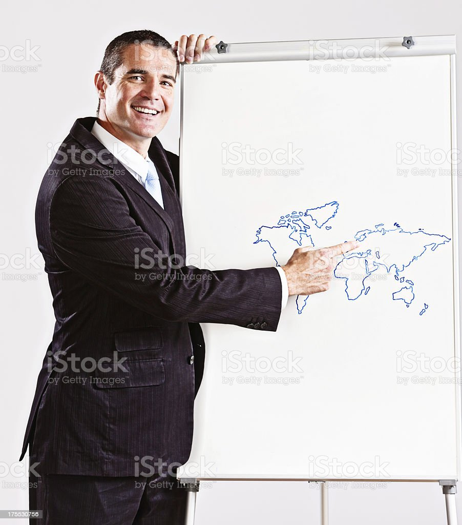 Smiling man indicates Eastern part of Europe on hand-drawn map royalty-free stock photo