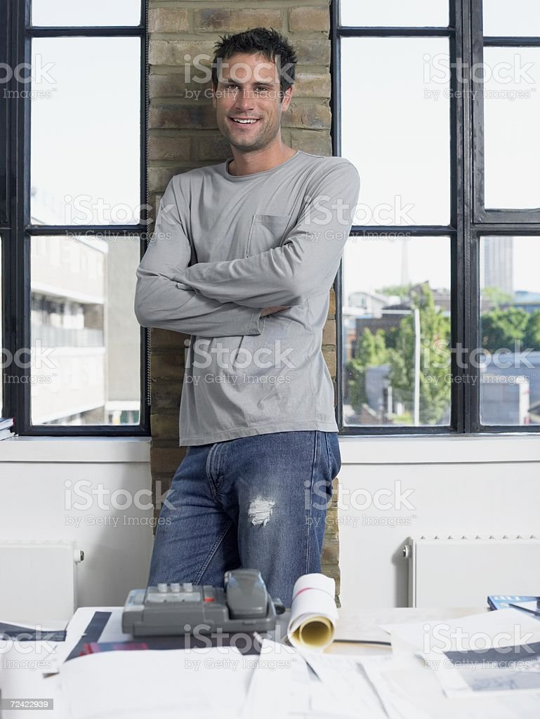 Smiling man leaning against a wall royalty-free stock photo