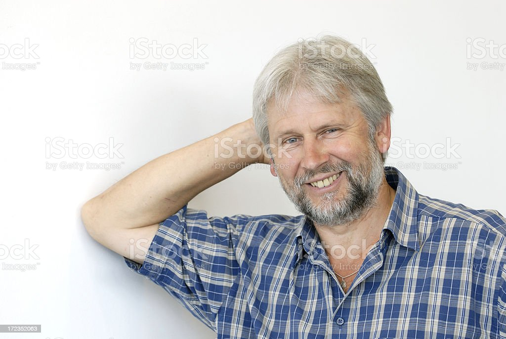 smiling man leaning at wall royalty-free stock photo