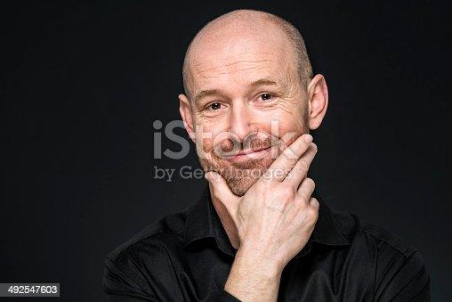 happy balding man looking at camera