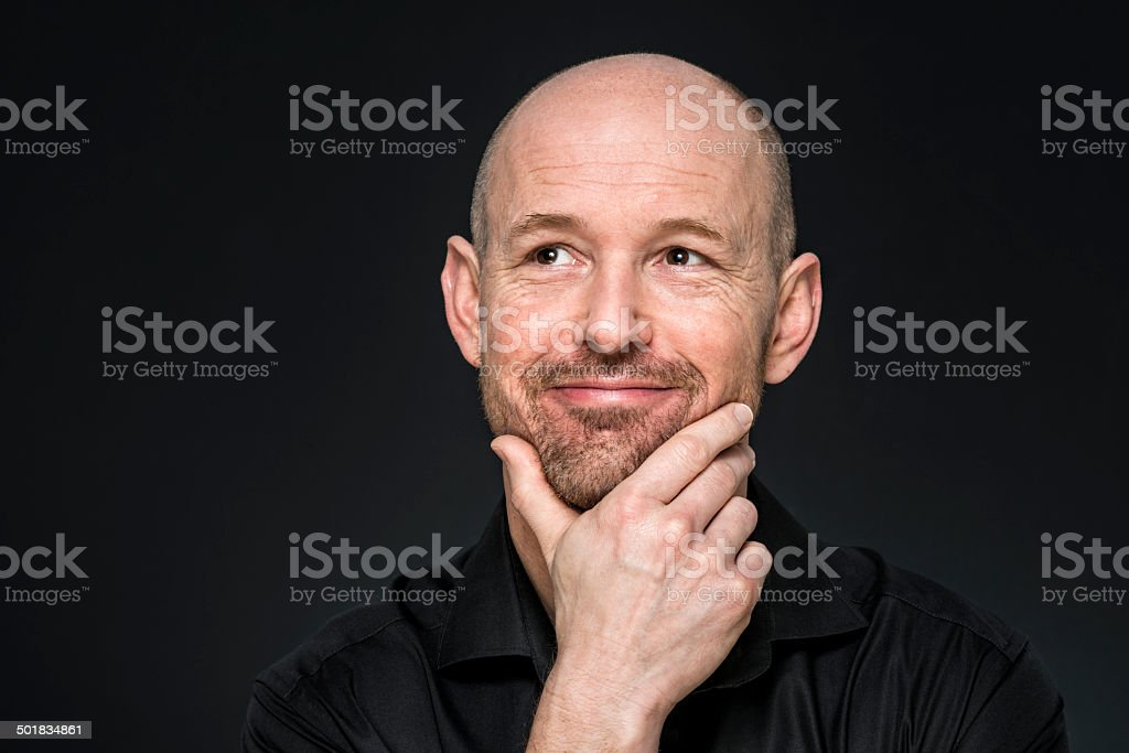 smiling man looking up stock photo