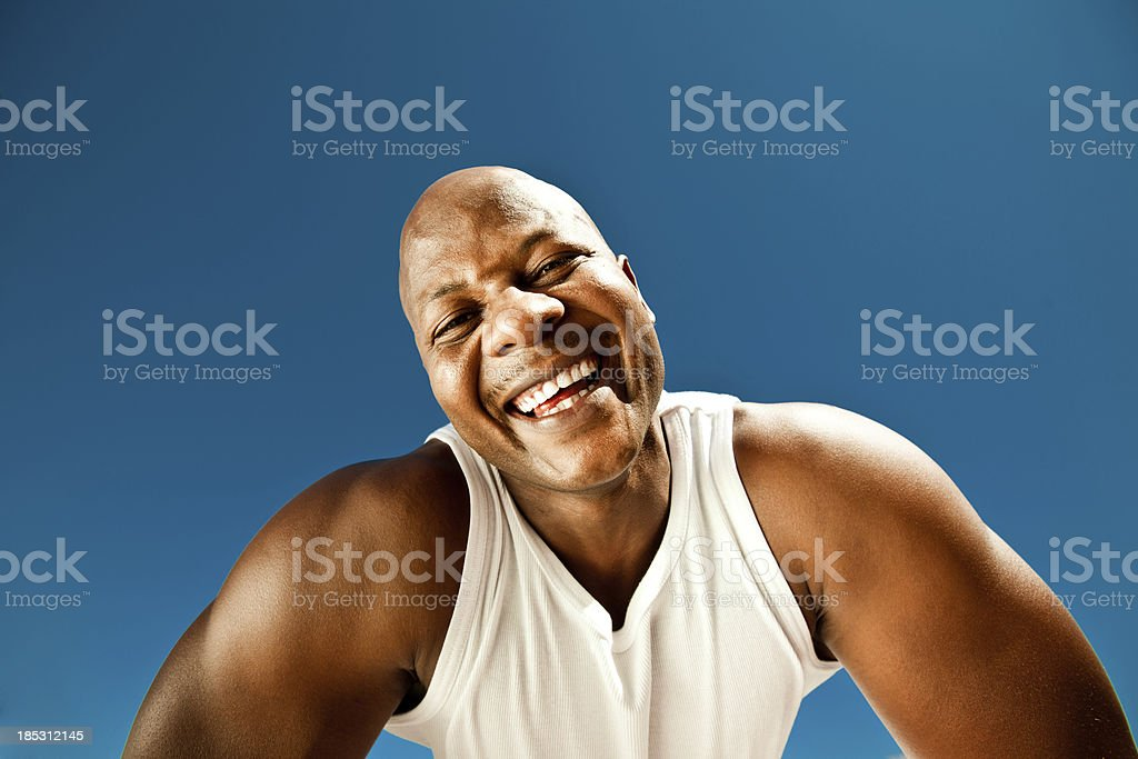 Smiling man Happy man laughing at the camera against blue sky. Adult Stock Photo
