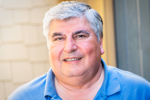 Smiling man Smiling overweight hispanic or middle eastern man looking at the camera armenian ethnicity stock pictures, royalty-free photos & images