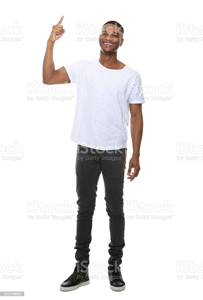 Smiling man pointing finger showing copy space stock photo