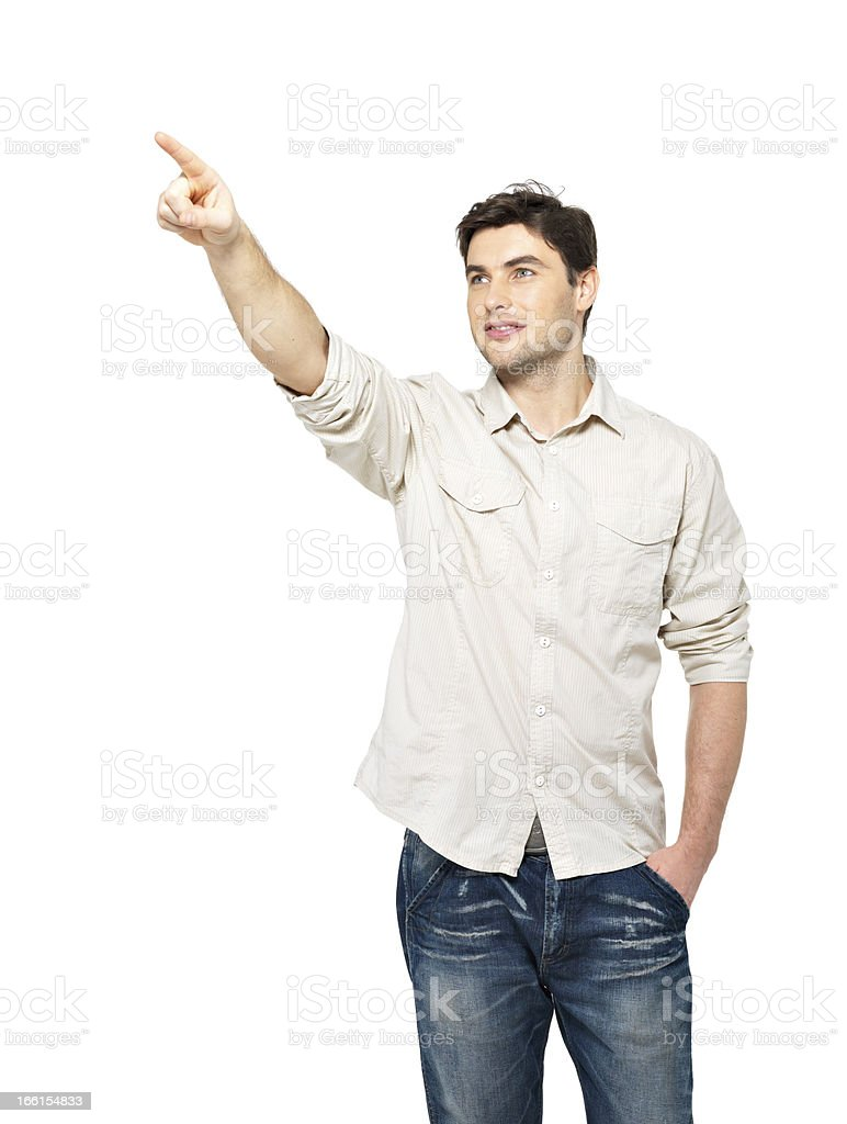 smiling man points with finger on something royalty-free stock photo