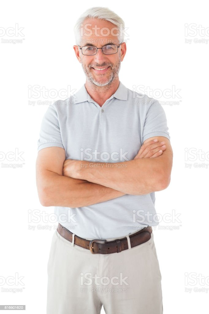 Smiling man posing with arms crossed stock photo