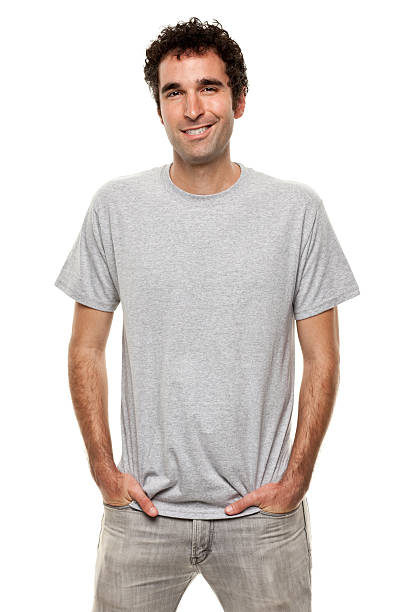 smiling man posing with hands in pockets - disdainful stock pictures, royalty-free photos & images