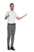 istock smiling man presenting and making the ok sig 1131989419