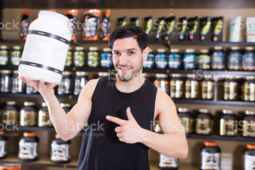 Smiling man seller demostration sport products stock photo