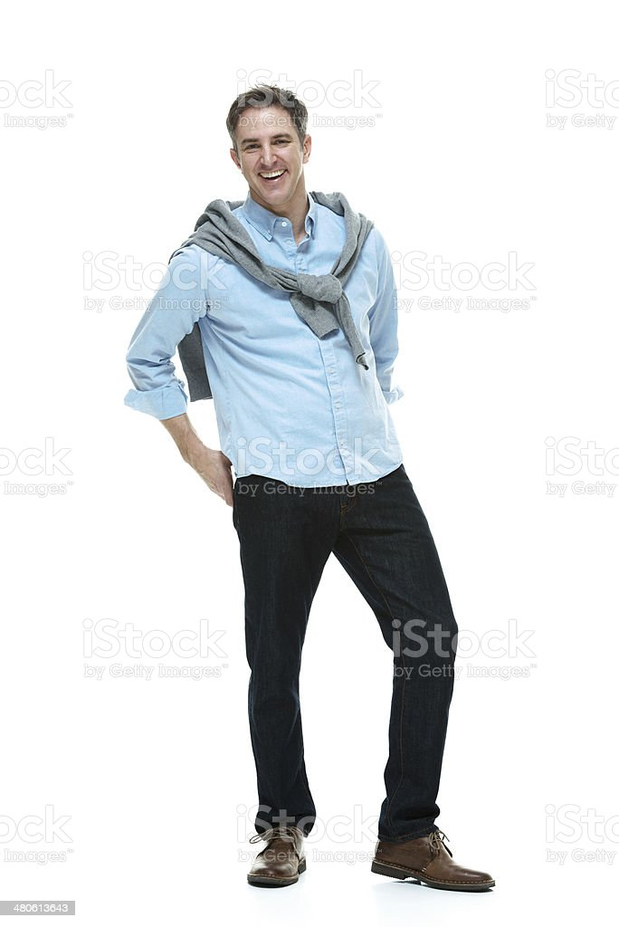 Smiling man standing and looking at camera stock photo