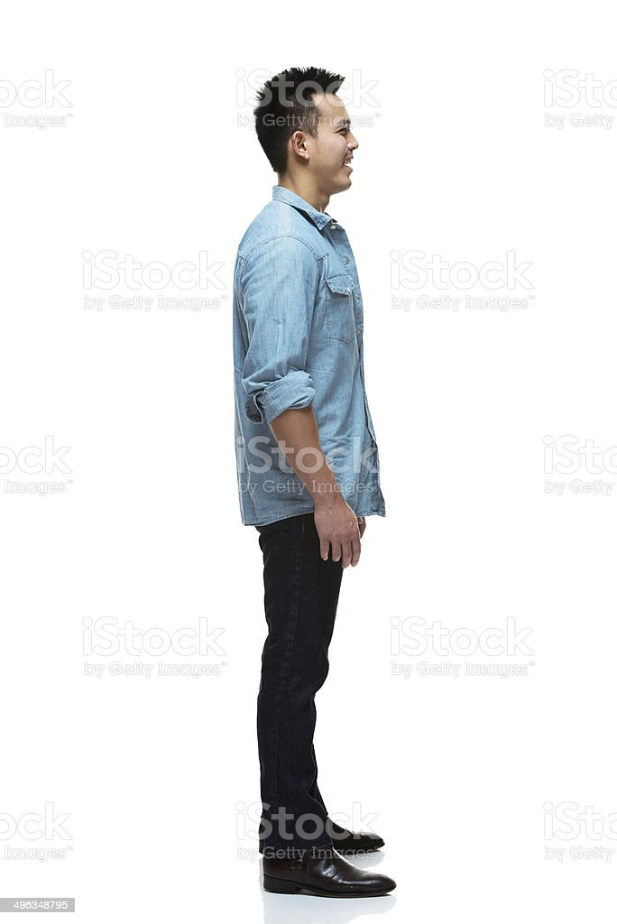 Smiling man standing and looking away royalty-free stock photo