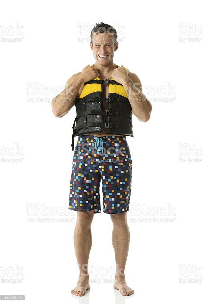 Smiling man standing in life jacket royalty-free stock photo