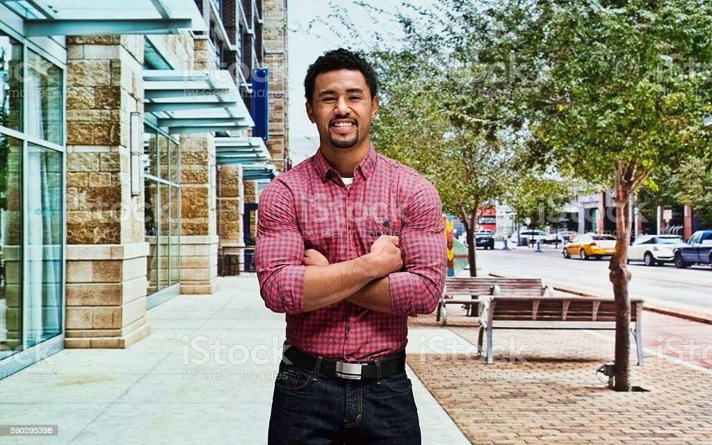 Smiling man standing outdoors royaltyfri bildbanksbilder