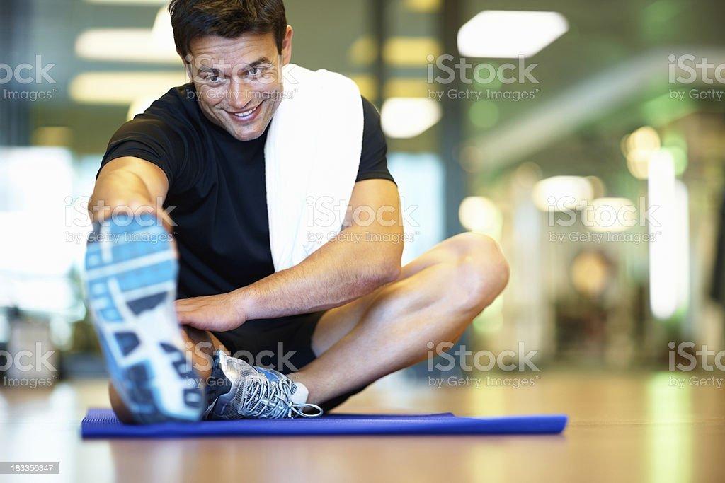 Smiling man stretching royalty-free stock photo