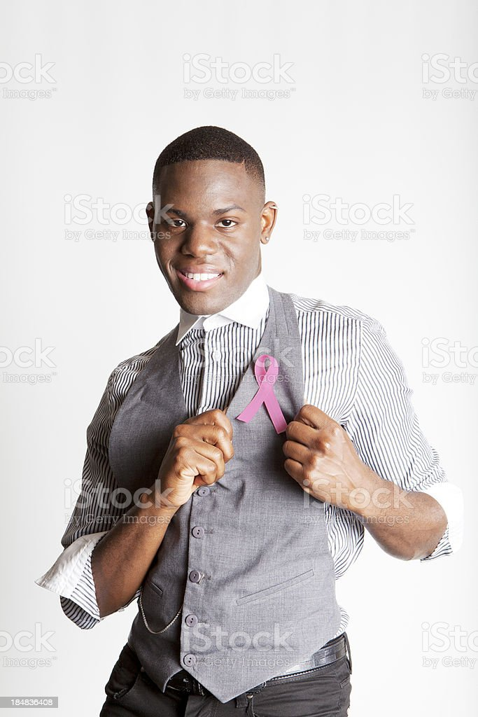 Smiling Man Supporting Breast Cancer Awareness Vertical stock photo